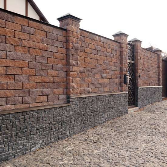 Decorative stone for a fence